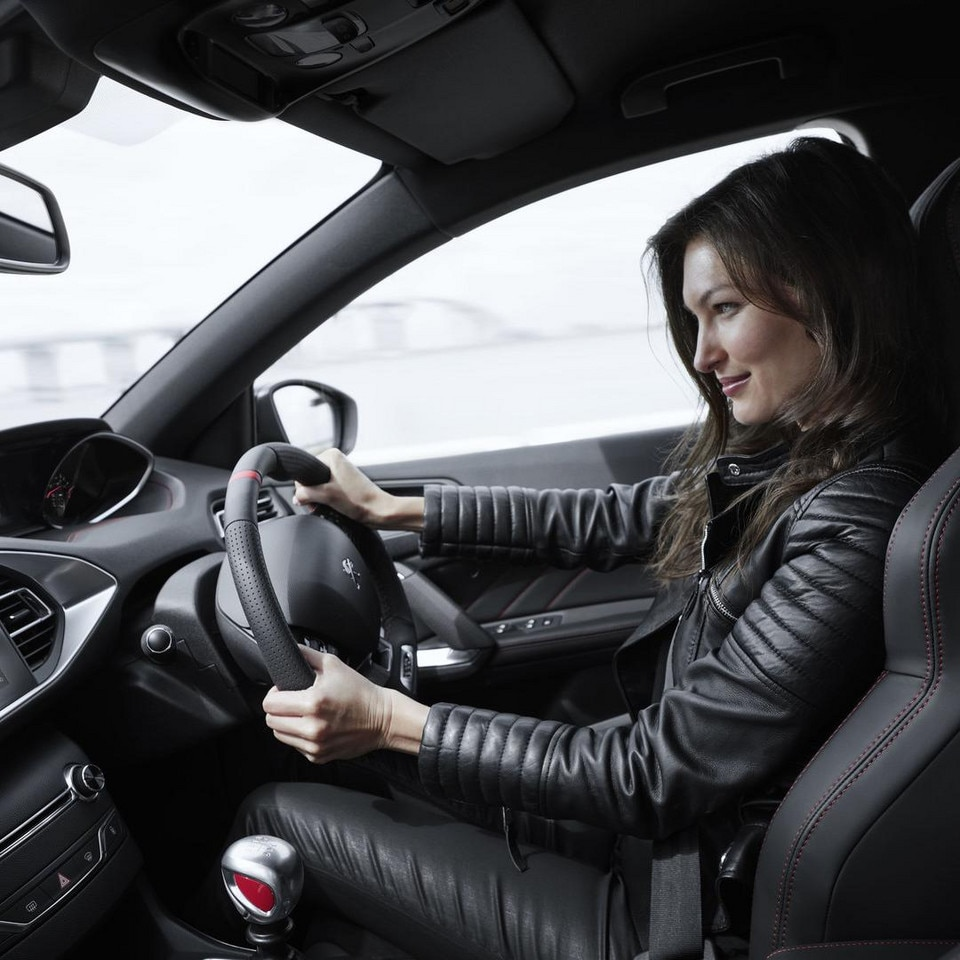 Woman driving Peugeot 308 GTi by Peugeot Sport