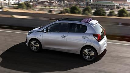 White Peugeot 108 Top! with roof retracted