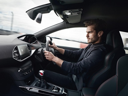 Man driving Peugeot 308 GTi by Peugeot Sport