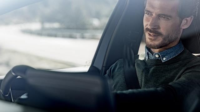 Man driving Peugeot 308
