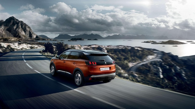 PEUGEOT 3008 HYBRID4 SUV: on the road, taking a bend
