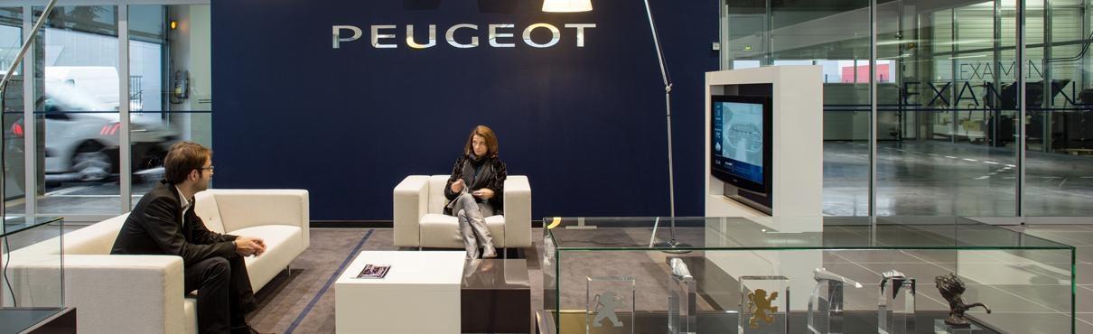 Customers in Peugeot showroom