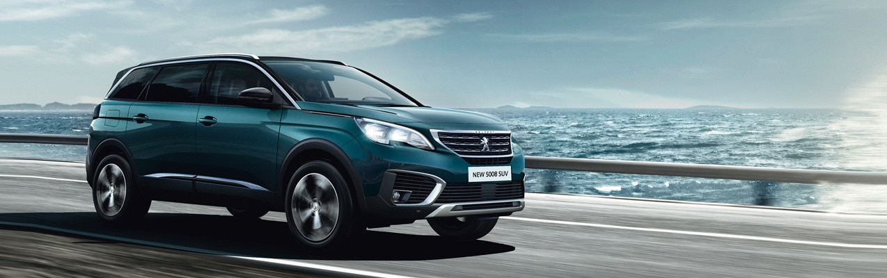New blue Peugeot 5008 SUV driving